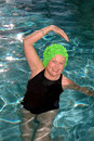 Senior woman stretching pool Stock Photography