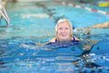Senior woman swimming in the pool Royalty Free Stock Photo