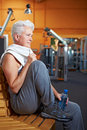 Senior woman taking break in gym Stock Photography