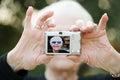Senior woman taking a self portrait photograph Royalty Free Stock Photo
