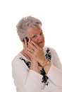 Senior woman talking on her cell phone. Royalty Free Stock Photo