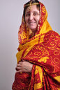 Senior woman in traditional indian clothing and jeweleries portrait of a Royalty Free Stock Photo