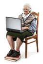 Senior woman using laptop computer ower white isolated on Stock Images