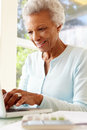 Senior woman using laptop at home Royalty Free Stock Photography