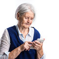 Senior woman using smartphone over white background Royalty Free Stock Image