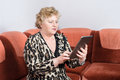 Senior woman using tablet pc at home Royalty Free Stock Photos
