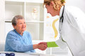 Senior woman visiting a doctor shakes hands with female patient Royalty Free Stock Images