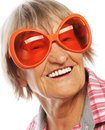 Senior woman wearing big sunglasses doing funky action isolated on white background Stock Images