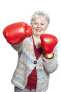 Senior woman wearing boxing gloves smiling white background Royalty Free Stock Photography