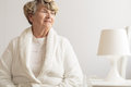 Senior woman wearing dressing gown at home Royalty Free Stock Image