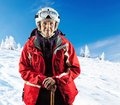 Senior woman wearing ski jacket on snowy slope and goggles in mountains with clipping path Royalty Free Stock Photography