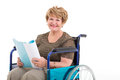 Senior woman wheelchair portrait of in a holding a book Royalty Free Stock Images