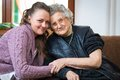 Senior woman women with her home caregiver Royalty Free Stock Photography
