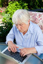 Senior Woman working on Laptop Stock Images