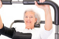 Senior woman at workout active in front of white background Royalty Free Stock Photos
