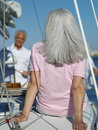 Senior woman on yacht rear view women Royalty Free Stock Photography