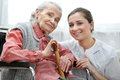Senior women with her caregiver at home Stock Images