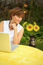 Senior women with laptop Stock Photography