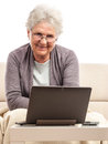 Senior women with notebook working at home woman using or tablet keypad dock isolated on white background Royalty Free Stock Photo