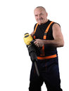 The senior worker with the hard tool Royalty Free Stock Photo