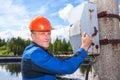 Senior worker man turning the power switch caucasian Stock Photo