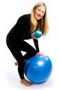 Senior workout round two woman working out with dumbbell weights and exercise ball Royalty Free Stock Images