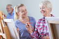 Seniors Attending Painting Class With Teacher Royalty Free Stock Photo
