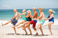 Seniors dancing in a row at the beach Royalty Free Stock Photo