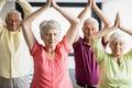 Seniors doing yoga with closed eyes
