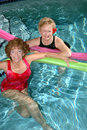 Seniors friends swimming pool Royalty Free Stock Photography