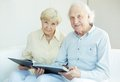 Seniors at home portrait of a candid senior couple looking camera leisure Royalty Free Stock Image