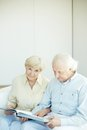Seniors at home portrait of a candid senior couple looking camera leisure Stock Photography