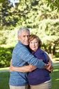 Seniors in love in a summer park Royalty Free Stock Photos