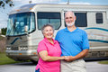 Seniors and Luxury Motor Home Stock Image