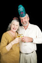 Seniors party on new years eve senior couple a bit drunk champagne at a year s black background Stock Photos