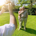 Seniors photographing retired couple having their photo taken Royalty Free Stock Photos