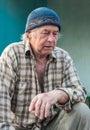 Seniors portrait of contemplative old caucasian man looking down Stock Photo