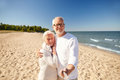 Seniors taking picture with selfie stick on beach Royalty Free Stock Photo