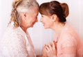 Seniors woman with her caregiver at home women see my other works in portfolio Royalty Free Stock Image