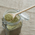 Senna leaves chopped in a wooden spoon above the jar Stock Image