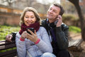 Senor man and woman with mobile phones Royalty Free Stock Photo