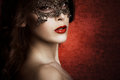 Sensual beautiful young woman lace mask studio shot Stock Image