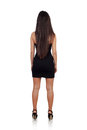 Sensual brunette girl back with black dress isolated on a white background Royalty Free Stock Image
