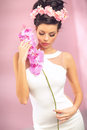 Sensual brunette girl with flower pink Stock Photo