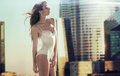Sensual brunette lady in the skyscraper woman Stock Images
