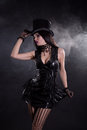 Sensual cabaret girl in fetish dress and tophat black bead necklace Stock Image