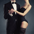 Sensual couple art photo of a young in lingerie and a tuxedo Royalty Free Stock Photography