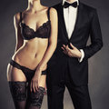 Sensual couple art photo of a young in lingerie and a tuxedo Royalty Free Stock Image