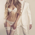 Sensual couple art photo of a young in lingerie and a tuxedo Royalty Free Stock Photo