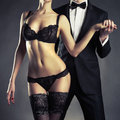 Sensual couple art photo of a young in lingerie and a tuxedo Royalty Free Stock Photos